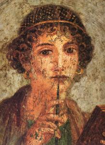Ung kona með blýant og bók. Veggskreyting sem fannst í rústum fornrómversku borgarinnar Pompeii sem grófst í eldgosi Vesúvíusar 79 e.Kr. Mynd: Wikimedia Commons